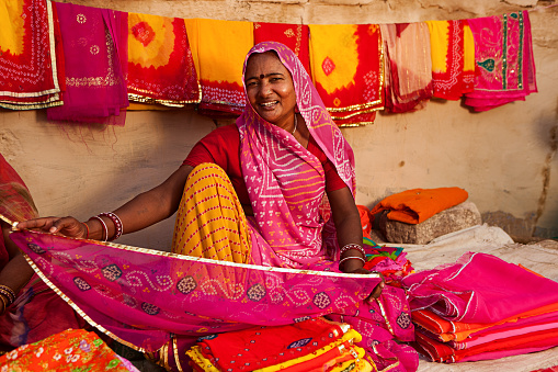 Woman Selling Colorful Fabrics Stock Photo - Download Image Now