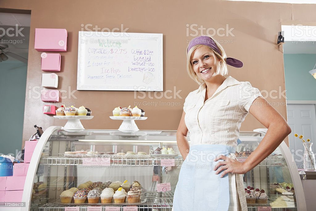 Woman selling cupcakes stock photo