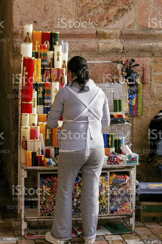 woman selling devotionals at the entrance of a Catholic church stock photo