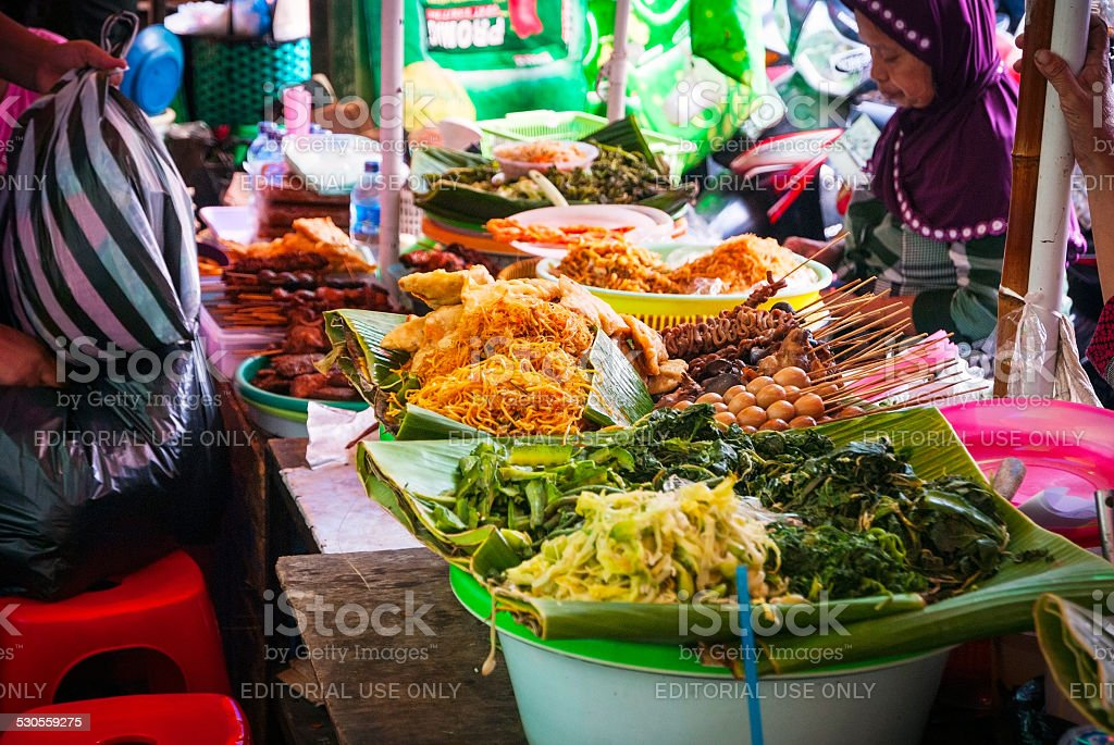 Woman selling food at local food market, Indonesia stock photo