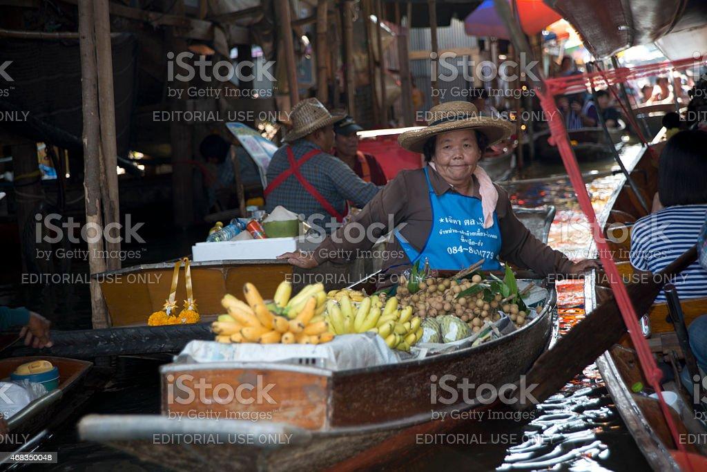 woman selling fruit at floating market Bangkok royalty-free stock photo