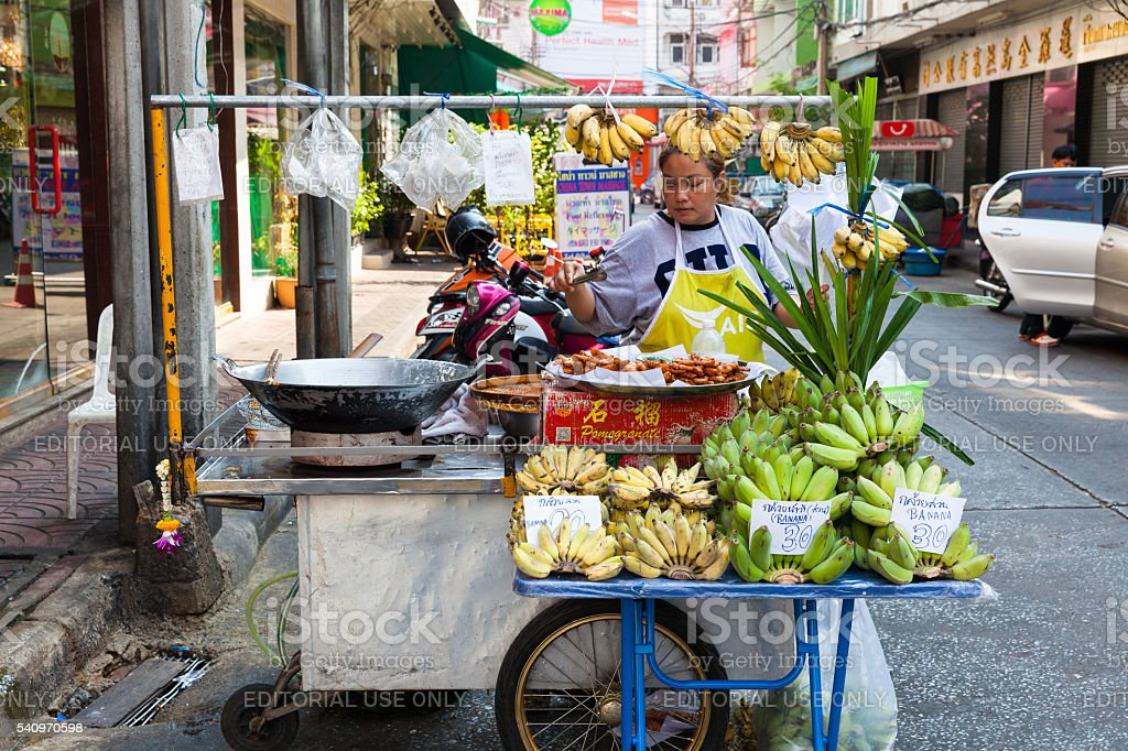 Woman selling fruits on the street of Bangkok stock photo