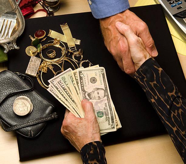 woman selling gold and silver - hand gold jewels bildbanksfoton och bilder