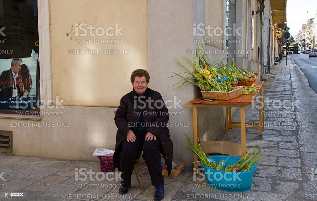 Woman Selling Palm Decorations for Palm Sunday, Sicily stock photo