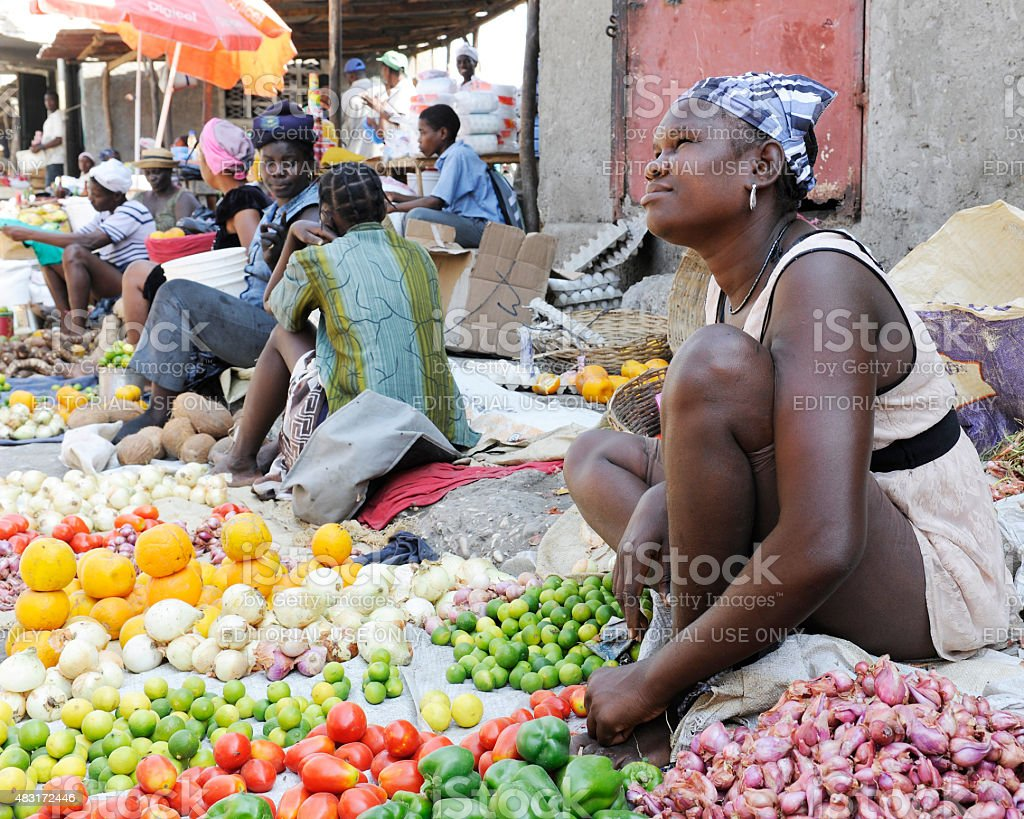 Woman Selling Produce stock photo