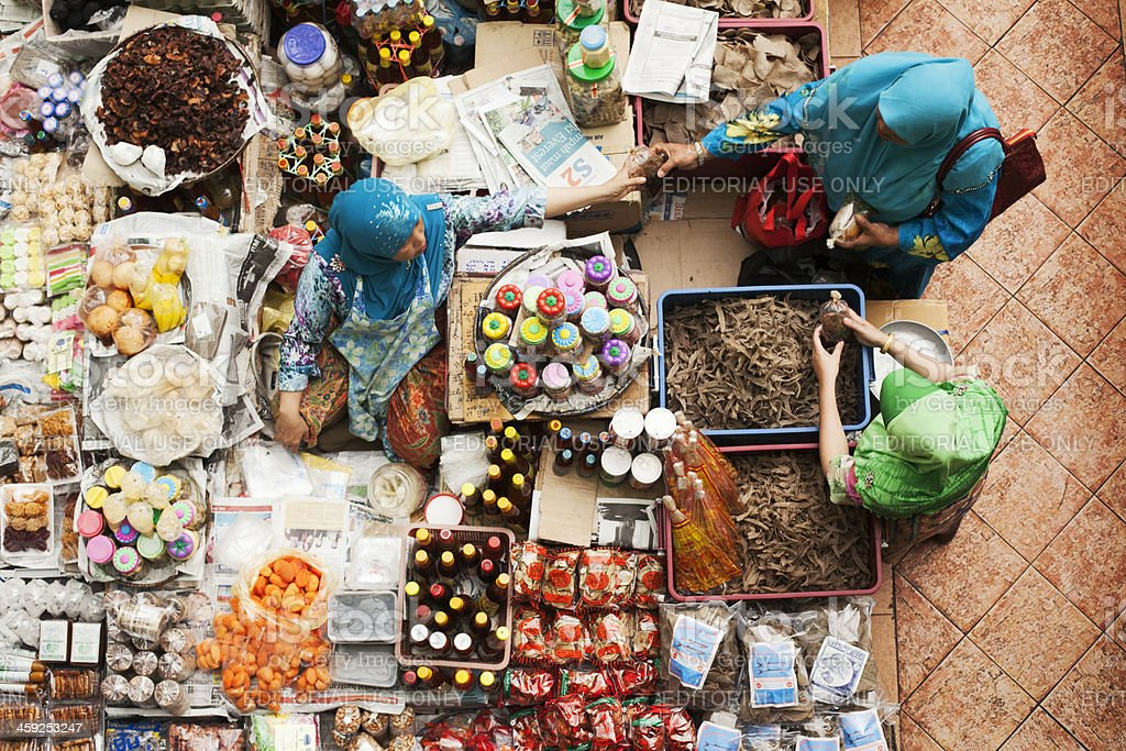 Woman selling species in a Malaysias wet market. royalty-free stock photo