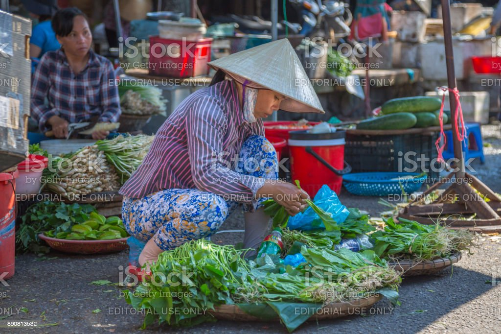 Woman selling vegetables at the hue market stock photo