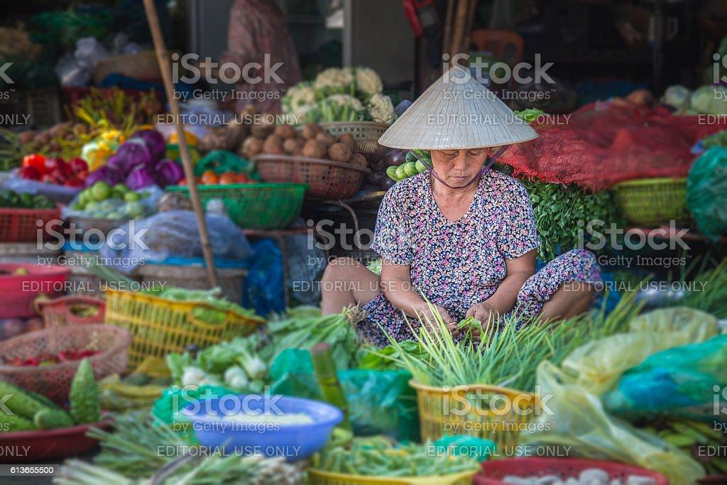 Woman selling vegetables in Hue market, Vietnam stock photo