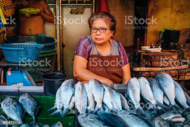 Woman sells fish on street market in manila philippines picture id931812114?b=1&k=6&m=931812114&s=612x612&h=4ettm8xkd55x9i5p7e4pqxdey2d5g1lgwgzbbgyeaoe=