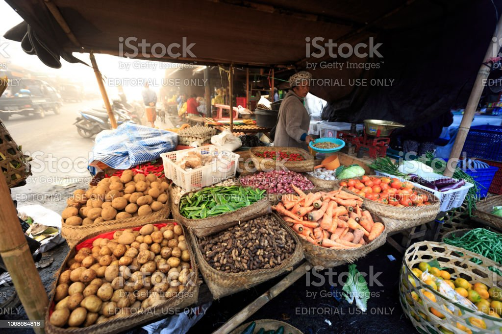 An unidentified Balinese Hindu woman sells fresh local produce at her...