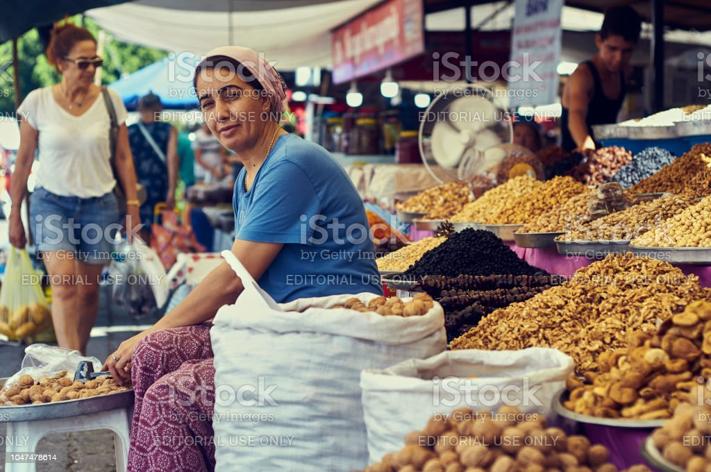 Woman sells nuts and oriental sweets stock photo