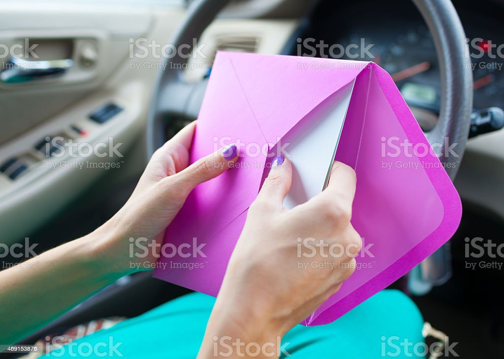 woman sending a letter by mail stock photo
