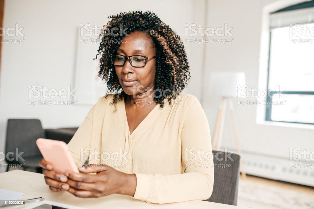 Woman sending a message stock photo