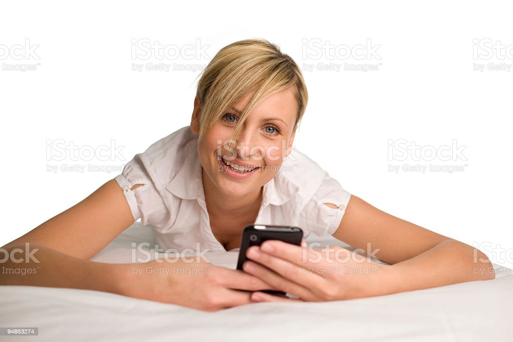 Woman sending a text message stock photo