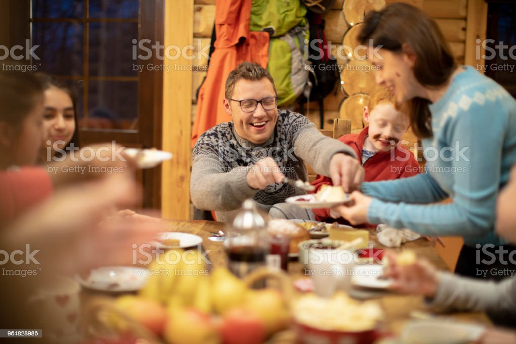 Serving Dessert to her Family royalty-free stock photo