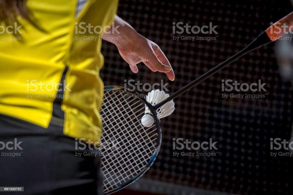 Woman serving a shuttlecock stock photo