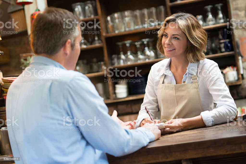 Woman serving at a coffee shop royalty-free stock photo