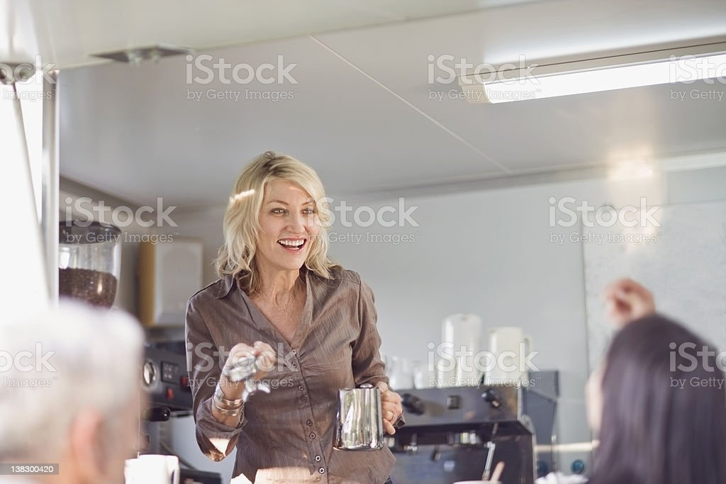Woman serving coffee in food cart stock photo