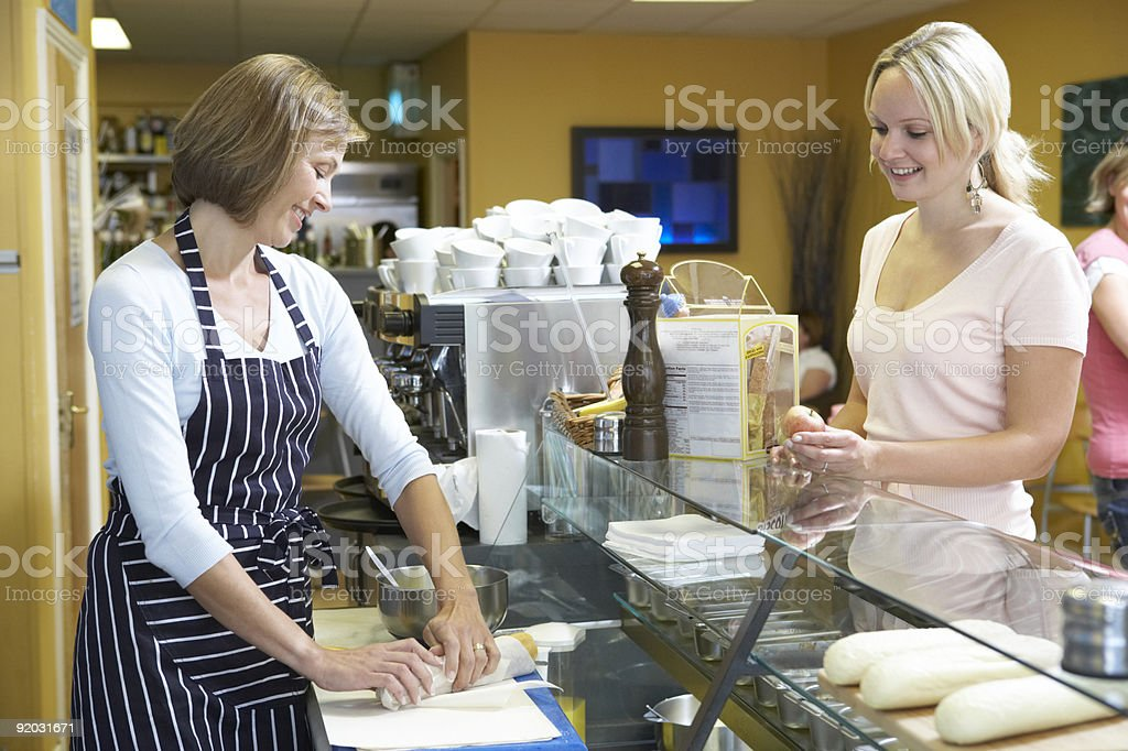Woman serving customer in restuarant royalty-free stock photo