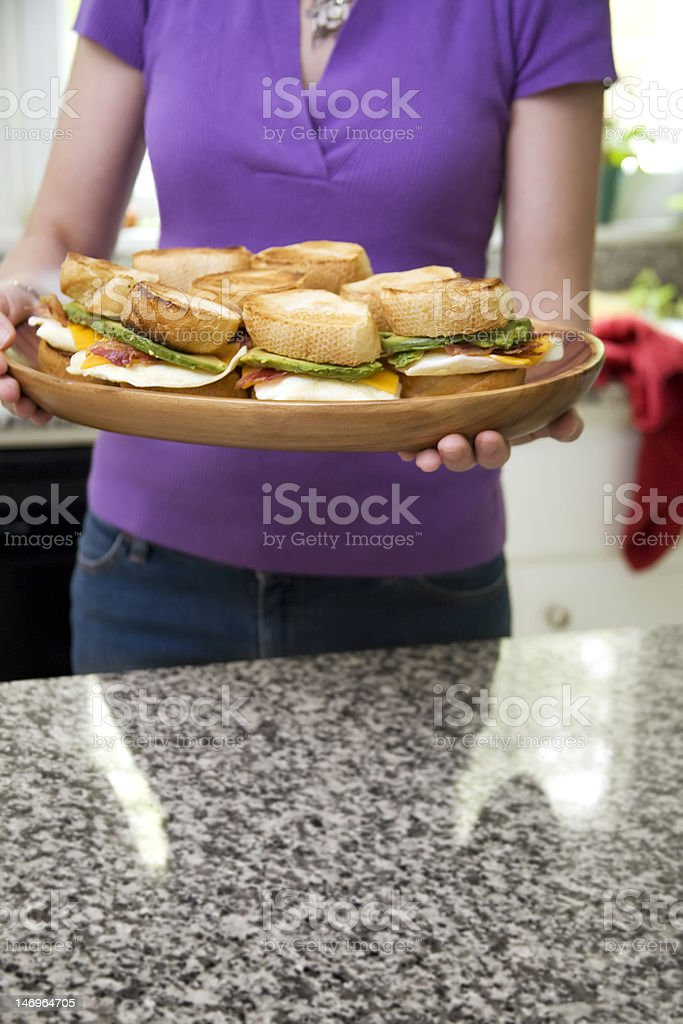 Woman Serving Egg Sandwiches royalty-free stock photo