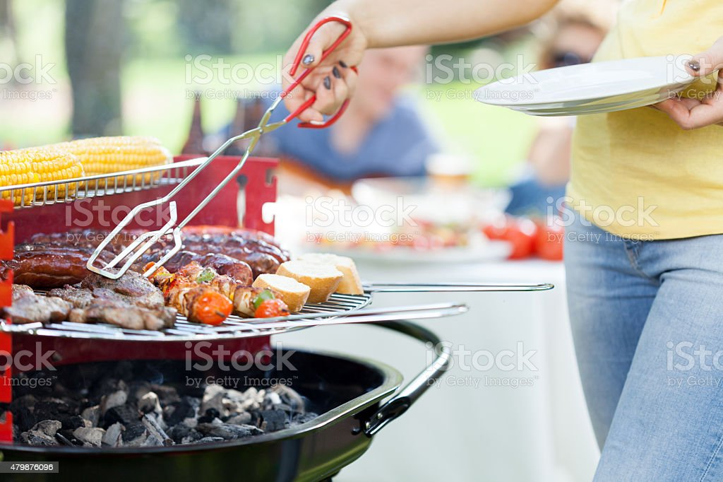 Woman serving grilled steak stock photo