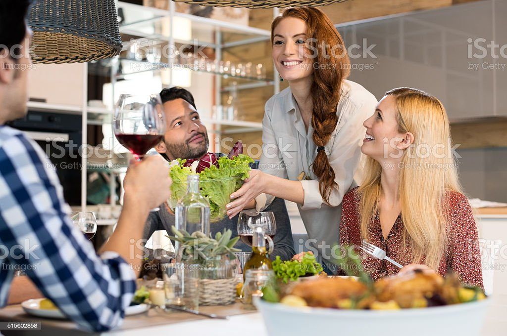 Woman serving salad stock photo