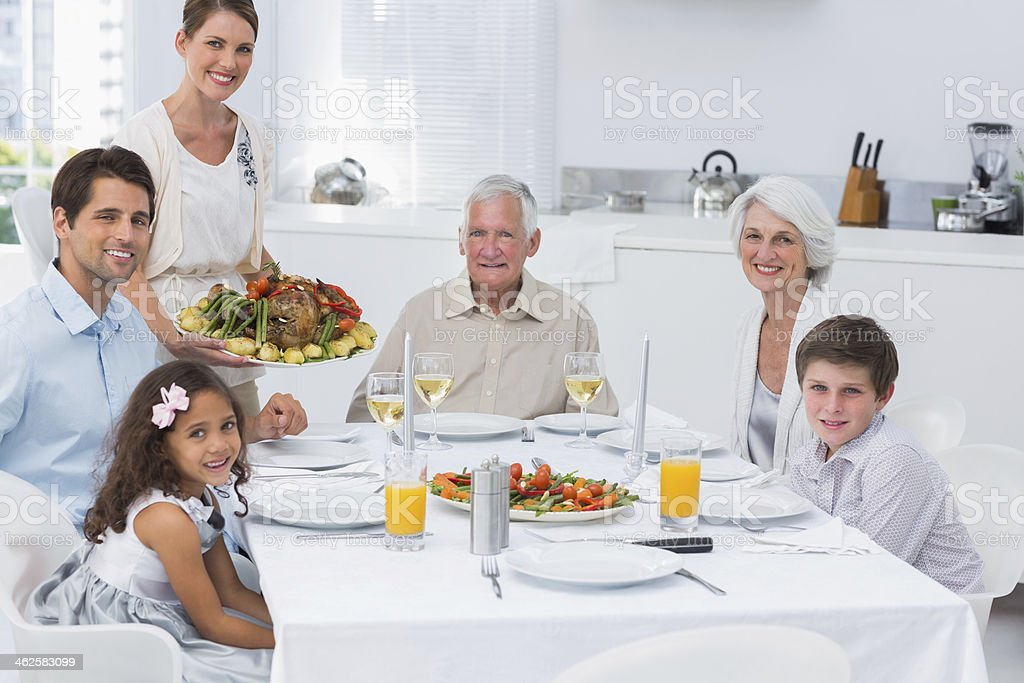 Woman serving the dinner to her family royalty-free stock photo