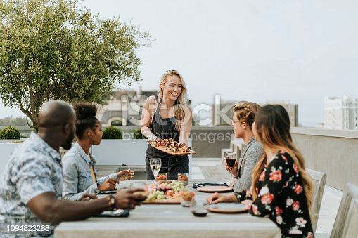istock Woman serving vegan barbecue to her friends 1094823268