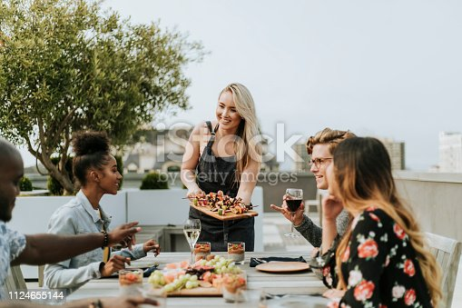 istock Woman serving vegan barbecue to her friends 1124655144