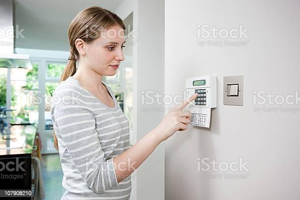 Woman setting burglar alarm picture id107908210?b=1&k=6&m=107908210&s=612x612&h=kvex8hdovfkhrzk0gnfzmdhoakvdxivskx43 3bl8v4=