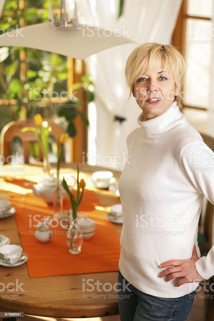 Woman setting the table for tea of coffee time royalty-free stock photo
