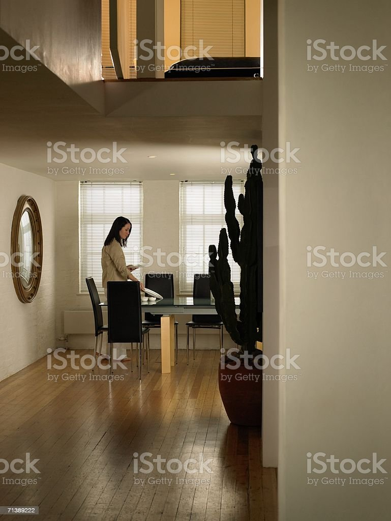 Woman setting the table royalty-free stock photo