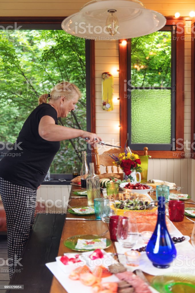 Woman setting the table stock photo