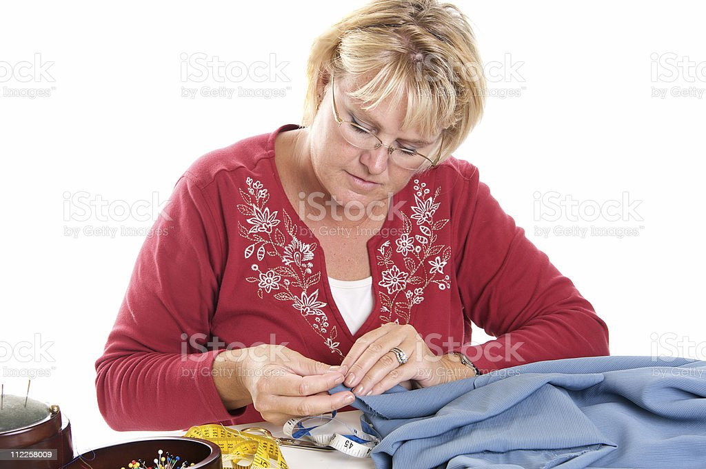 Woman Sewing by Hand royalty-free stock photo