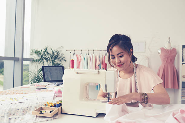 woman sewing - seam stock photos and pictures