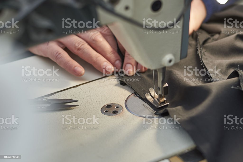 A Woman Sews On An Electric Sewing Machine Stock Photo Download Image Now Istock