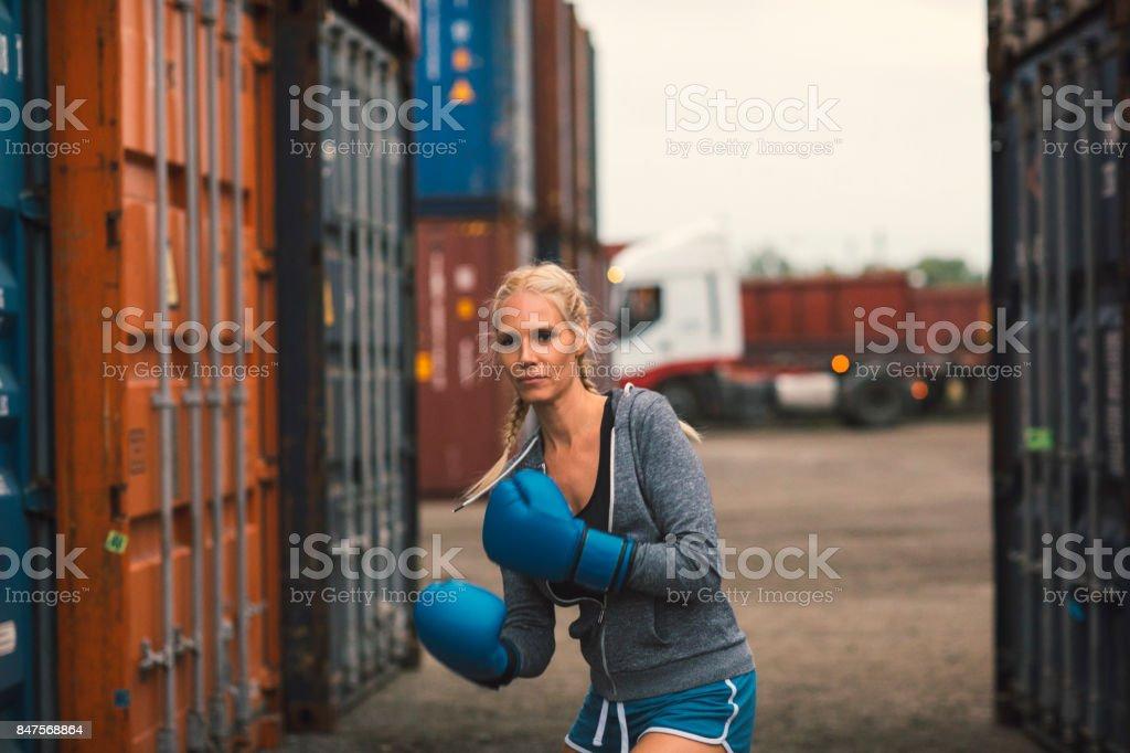 Woman shadow boxing stock photo
