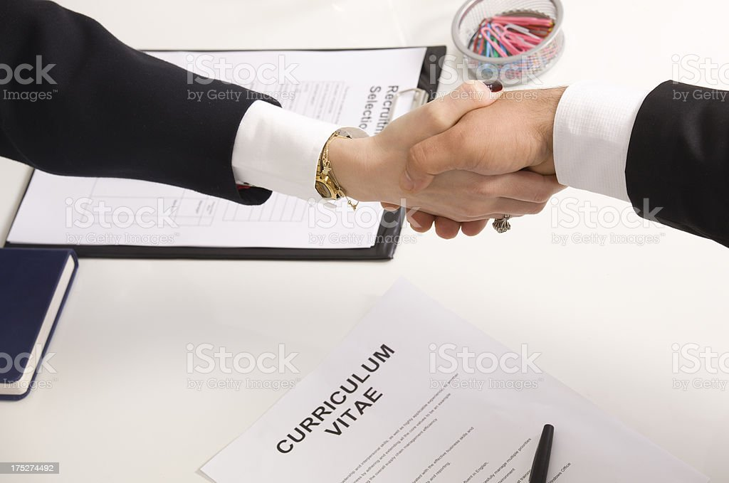 woman shaking hands with manager at job interview closeup royalty-free stock photo