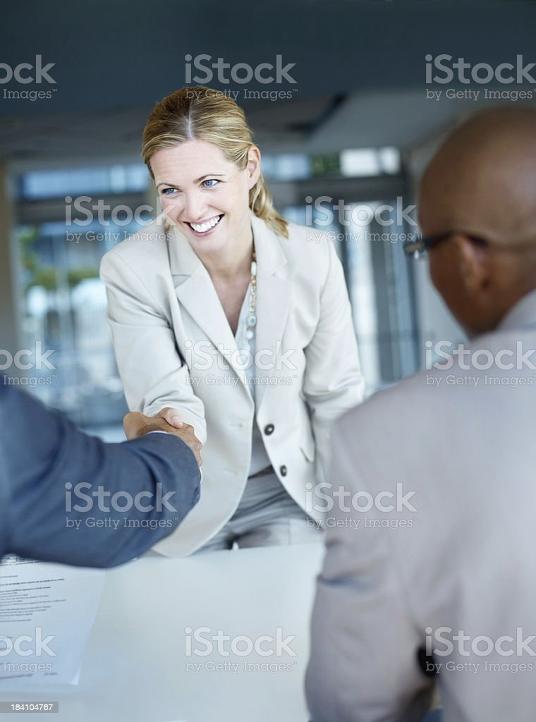 Woman shaking hands with panel of business interviewers royalty-free stock photo