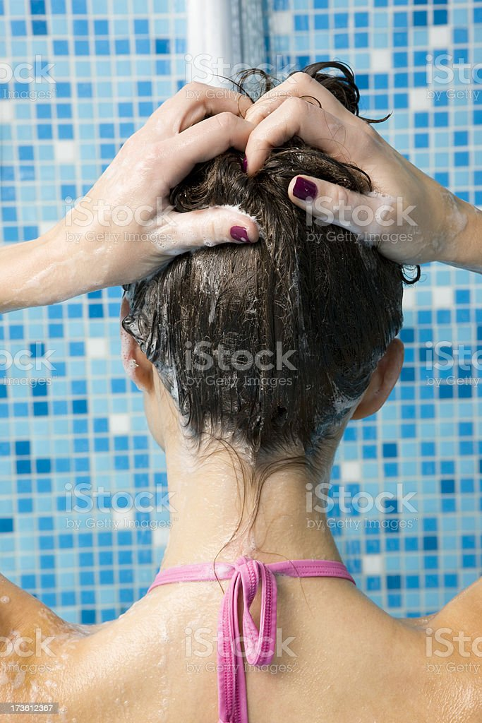 Woman shampooing her hair royalty-free stock photo