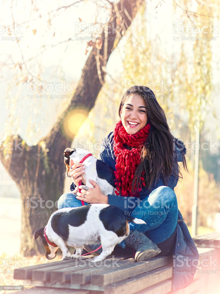 Woman shares a beautiful moment with his dogs. stock photo