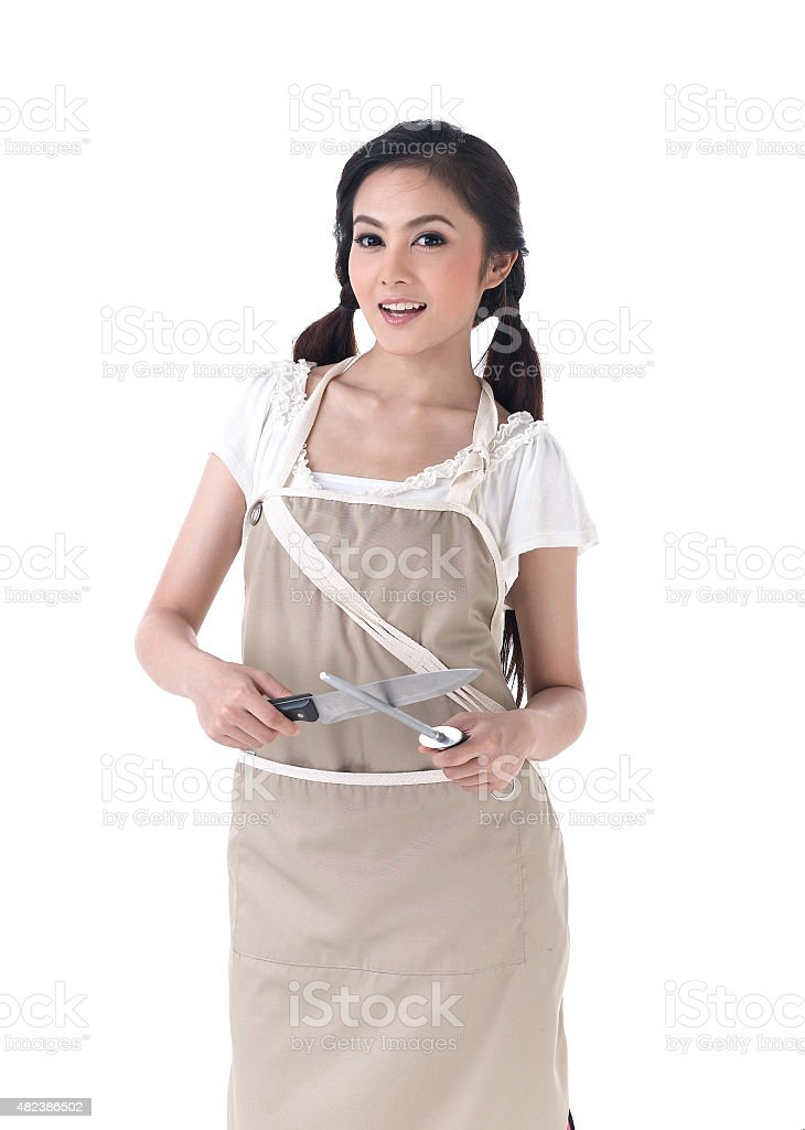 woman sharpening a knife with steel sharpener stock photo