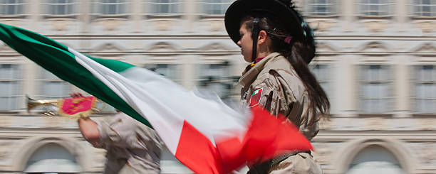 Woman sharpshooter soldier waving the italian tricolor flag stock photo