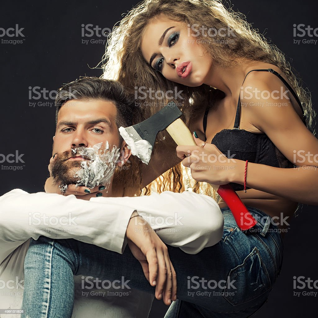 Woman shaving man stock photo