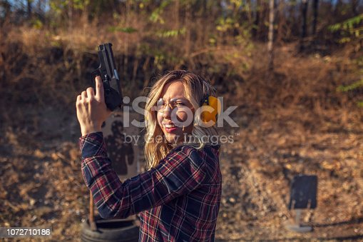 Woman practicing at a gun range
