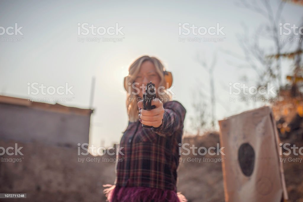 Woman practicing at a gun range