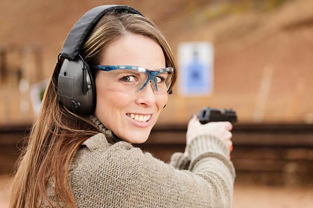 woman shooter at the shooting range - gun shooting stockfoto's en -beelden