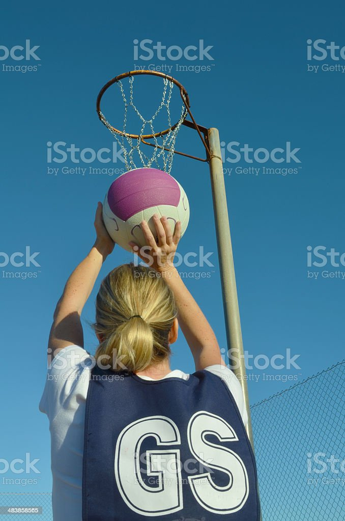 Woman Shooting a Netball royalty-free stock photo
