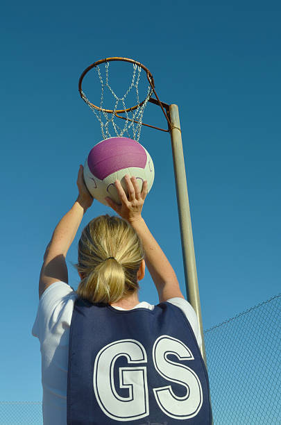 Woman Shooting a Netball stock photo