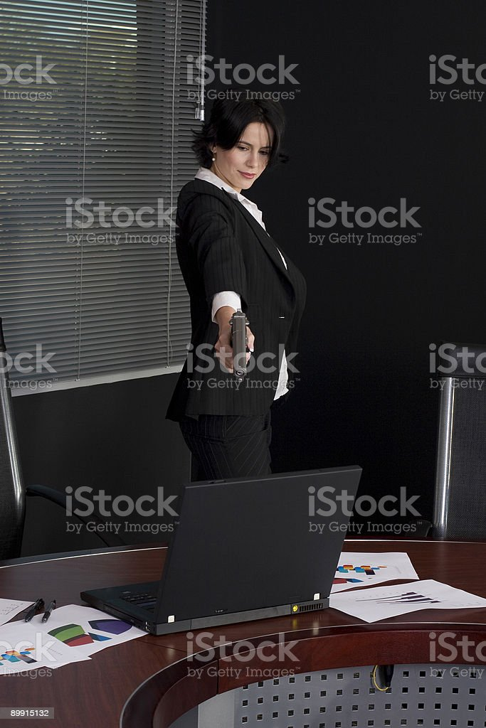 Woman shooting computer royalty free stockfoto